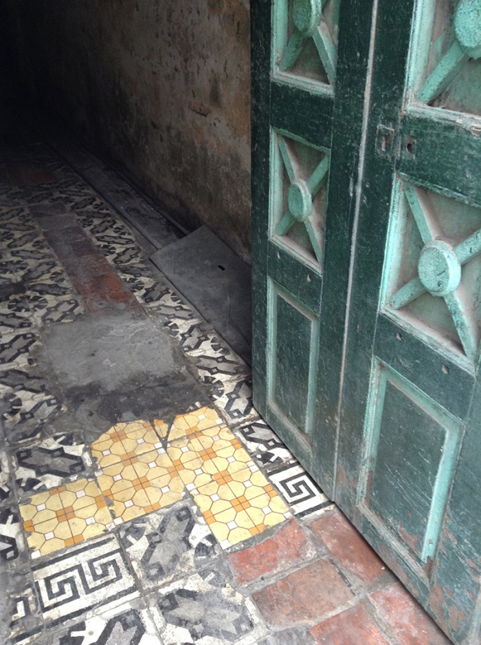 green_door_and_tiled_floor